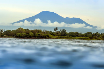 Clear sky over volcano and sea
