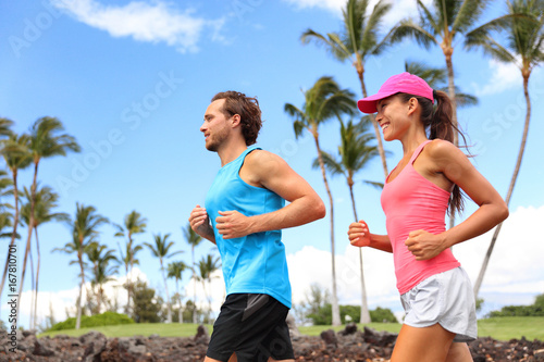 Happy Couple Running Together Training In Morning Summer