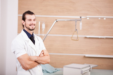 Portrait of Smiling male doctor on hospital background. Medicine and healthcare
