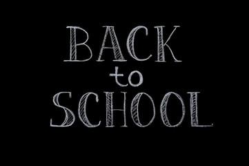 Chalk inscription Back to school on black background