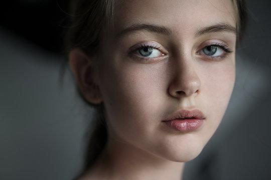 Art portrait of a beautiful young girl of ten years