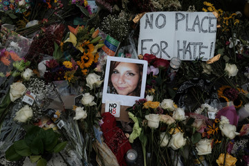 A photograph of Charlottesville victim Heyer is seen amongst flowers at the scene of the car attack on a group of protesters in Charlottesville