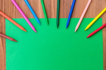 Back to school pattern for inscription. Children's drawing pattern for design. Paper and pencils on wooden background