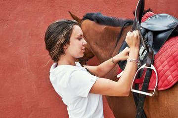 Brunette with braid wearing on saddle