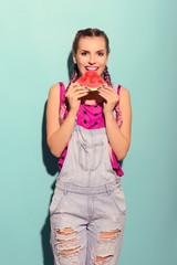 Healthy beautiful vegan woman eating watermelon. Summer happy colorful portrait.
