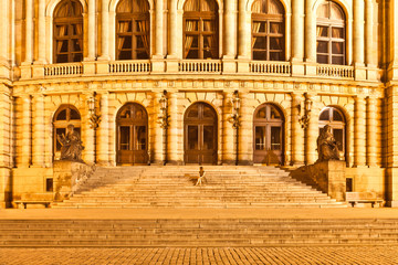 Woman sitting on the stairs of the Rudolfinum, Prague