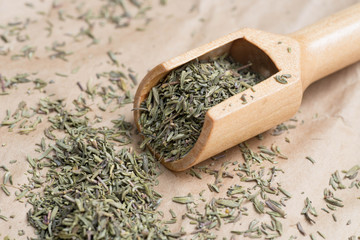 dried thyme leaves in measuring spoon