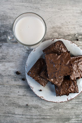 top view of Brownies with glass of milk