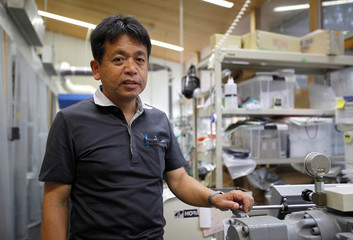 Kyoto University Professor Hiroyuki Yano poses for a photograph at his laboratory in Kyoto