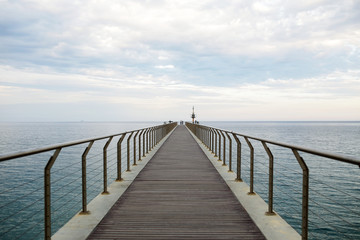 Lonely pier on a cloudy day