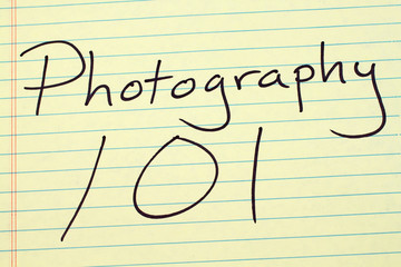 "The words ""Photography 101"" on a yellow legal pad"