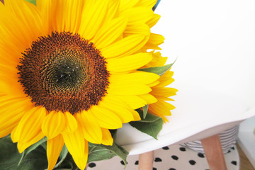 Background with a bouquet of yellow sunflowers with space for text.