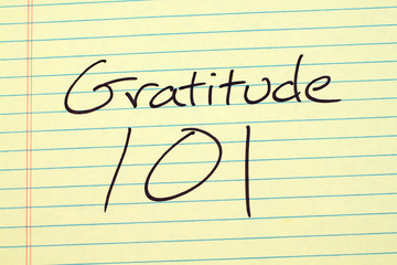 "The words ""Gratitude 101"" on a yellow legal pad"