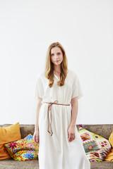 Beautiful Woman Wearing White Dress At Home