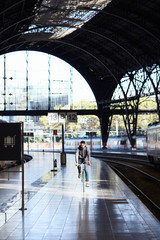 Young man riding a fixie bicycle in the railway station