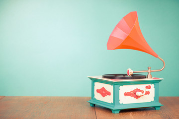 Retro old gramophone front mint green background