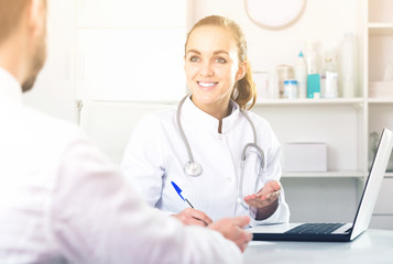 Smiling woman doctor consulting client