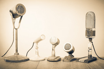 Retro old microphones for press conference or interview. Vintage style sepia photo