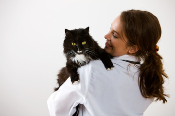 Veterinarian: Woman Holding Pet Cat