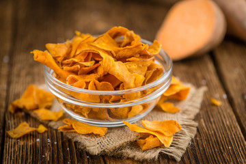 Fresh made Sweet Potato Chips on a rustic background