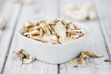 Portion of Dried Mushrooms on wooden background, selective focus