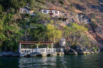 View from the lake of one of the picturesque cafe-restaurants on the shore of Lake Atitlan in Guatemala.