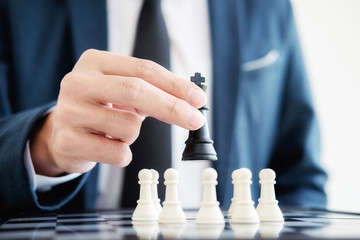 Hand of a business making a chess movement. Business concept strategy, leadership, team and success