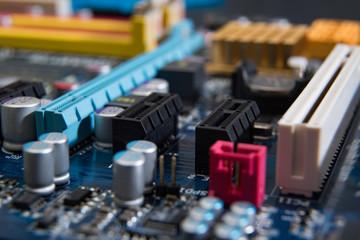 Closeup electronic circuit board background-defocused concept