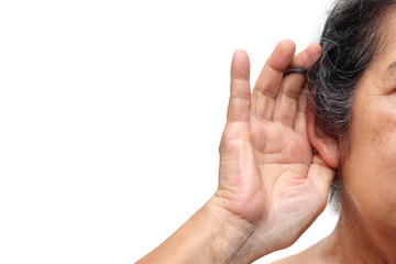 Old woman paying attention to listening sound, Age-related hearing loss problem in elderly.