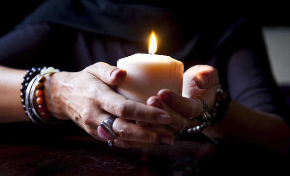hands holding a candle