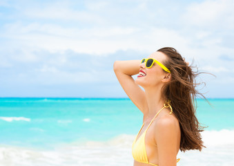 Happy summer day's. Woman on tropical beach relaxing and enjoying the sunshine.