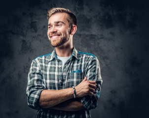 Bearded man over grey background.