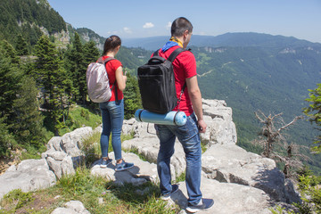 Eco tourism and healthy lifestyle concept. Young hiker girl end boy with backpack