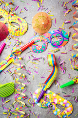 Colorful party accessories on gray background