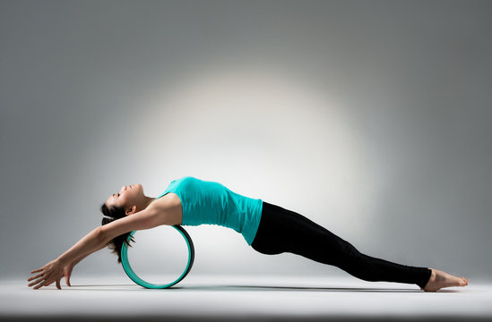 young gymnastics girl lying on the pilates ring