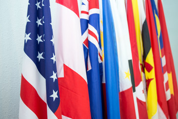 group of United States and North American Asia Pacific flags in International meeting