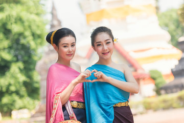 Beautiful Laos girls in traditional Lao traditional dress are standing at temple,Luang Prabang,vintage style,traditional suit.