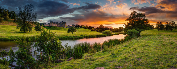 Panoramic Sunset over River Aln / The River Aln runs through Northumberland from Alnham to Alnmouth. Seen here in panorama below Alnwick Town and Castle on the skyline, as the sunsets Wall mural
