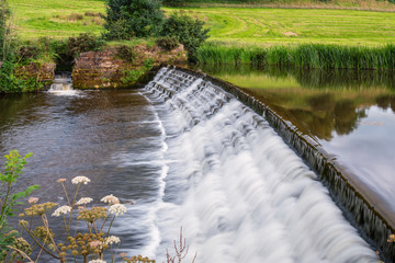 River Aln Weir and Fish Pass / The River Aln runs through Northumberland from Alnham to Alnmouth. Here below Alnwick is one of the weirs along its length
