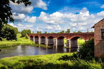 Red brick bridge over river Aleksupe in Kuldiga city, Latvia