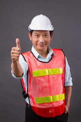 thumb up from confident, professional asian male engineer, civil construction, builder, architect, worker