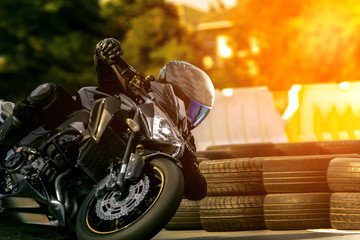 man riding sport motorcycle on racing track