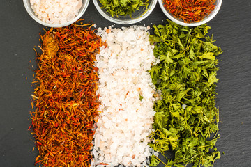 Various culinary spices and herbs, forming the flag of India