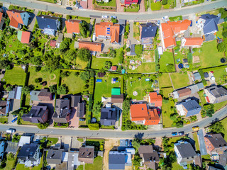 Aerial picture of a residential area with houses and gardens from a height of hundred meters