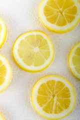 Lemon slice in bubble water white background. Top view.