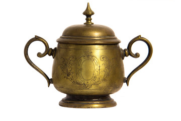 An old brass or bronze metal sugar bowl with a lid and ornament