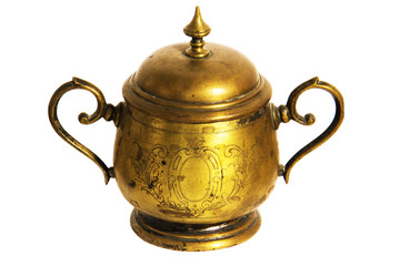 An old brass or bronze metal sugar bowl with a lid and ornament. Metal punctles with scratches and patina.