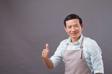 confident shopkeeper giving thumb up, concept of successful small business owner, shop manager, entrepreneur studio isolated