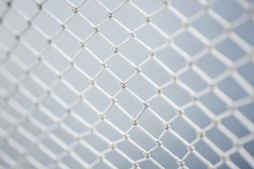 A material net that is a decoration on a yacht, performing protective functions. Texture or background.