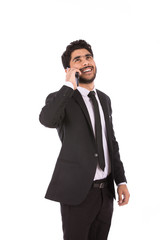Happy handsome young businessman smiling and making a call, guy wearing black suit and black tie, isolated on white background
